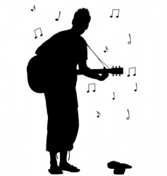 Man with guitar silhouette vector