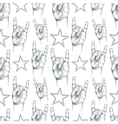 Seamless pattern with rock n roll sign and a stars vector