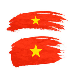 Grunge brush stroke with vietnam national flag on vector