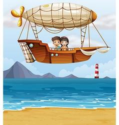 A boy and a girl riding an airship vector image