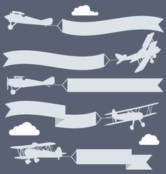 Silhouettes of biplanes with wavy greetings banner vector image vector image