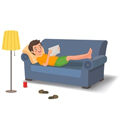 Young man lying on the couch with a tablet vector image vector image