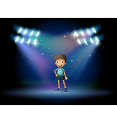 A stage with a young actor at the center vector image