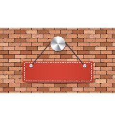 Red label is holding on brick wall vector image vector image