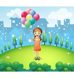 A girl holding balloons in the city vector image