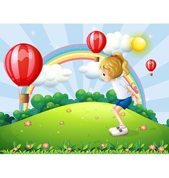 A girl playing in the hill with floating balloons vector