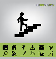Man on stairs going up black icon at gray vector