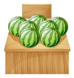A watermelon stand with an empty wooden signboard vector