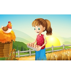 A young girl holding an egg tray vector image vector image