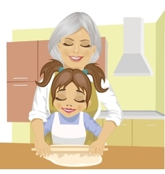 Grandmother teaching granddaughter to cook pizza vector