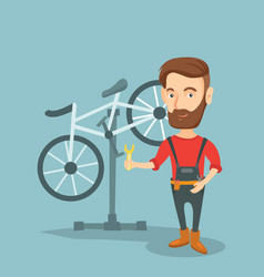 Caucasian bicycle mechanic working in repair shop vector