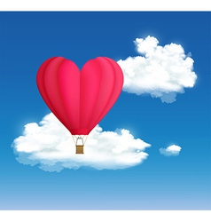 Hot air balloon in the shape of heart on the vector