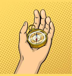 compass in hand pop art vector image