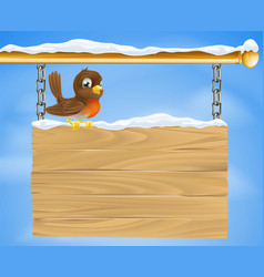 Christmas robin on wooden sign vector