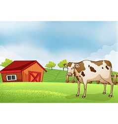 A cow in the farm with a barn house vector