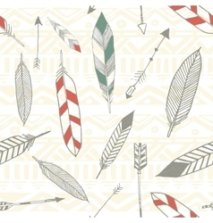 Seamless tribal pattern with feather and arrows in vector