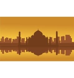 Silhouette of taj mahal and city vector