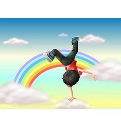A boy performing a break dance along the rainbow vector