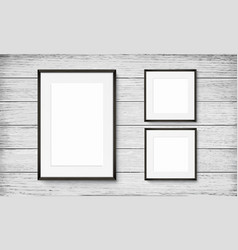 set of black frames on wooden background vector image