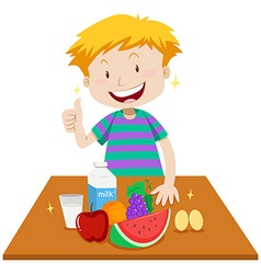 Little boy and healthy food on table vector
