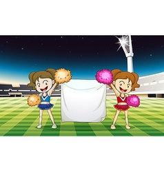 Two cheerdancers holding an empty banner vector image vector image