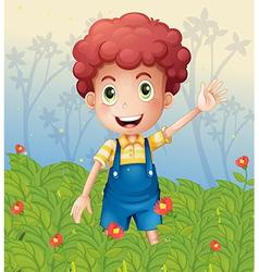A young boy in the garden vector image