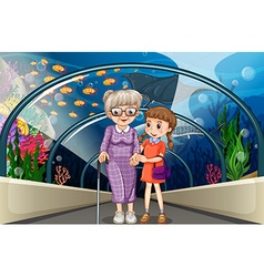 Grandmother and kid at aquarium vector