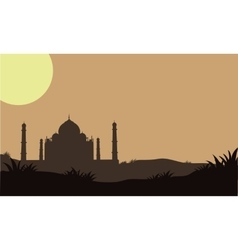 Silhouette of taj mahal in the fields vector