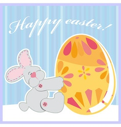Cute easter bunny holding egg vector