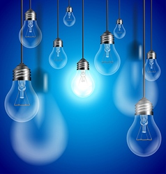 Light bulbs on blue background vector image vector image