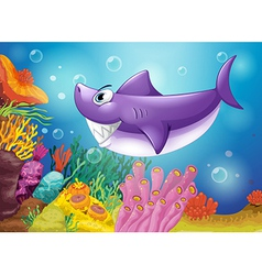 A smiling violet shark under the sea vector image