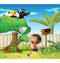 A boy catching the bird with an envelope vector image vector image