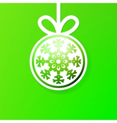 Christmas ball cutted from paper on green  eps8 vector