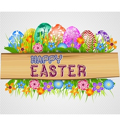 The easter bunny holding a basket of easter eggs vector