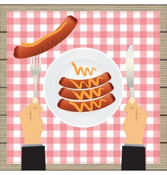 Sausages on a plate and hand with a knife vector