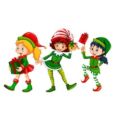 Three girls dressed in elf costume for Christmas vector image vector image