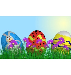 Easter eggs on springtime meadow vector