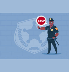 african american policeman with stop chat bubble vector image