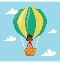 Woman flying in hot air balloon vector