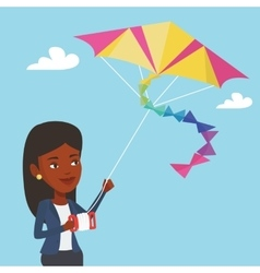Young woman flying kite vector