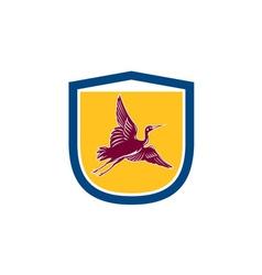 Heron crane flying side view shield retro vector