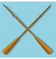 Two wooden oars on wavy background vector