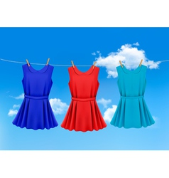 Set of colored dresses hanging on a clothesline on vector