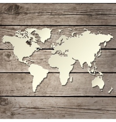 Paper world map on a wooden board vector