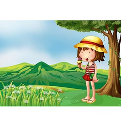A girl eating an icecream at the top of the hills vector image