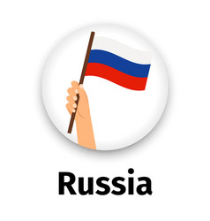 russian flag in hand round icon vector image