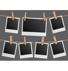 Retro photo frames hanging on rope isolated vector