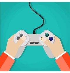 Hands holding wired old school gamepad vector