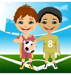Two cute multiracial youth soccer players vector