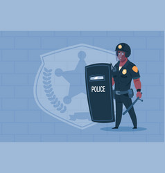 African american policeman hold shield wearing vector